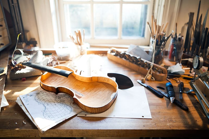 A high price violin being crafted in a workshop.