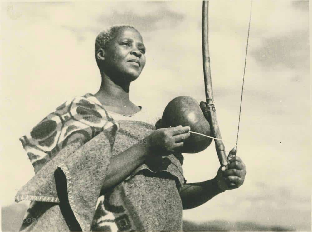 "Woman playing a ""Thomo"" an early African instrument similar to the berimbau in Basutoland (present day Lesotho)."