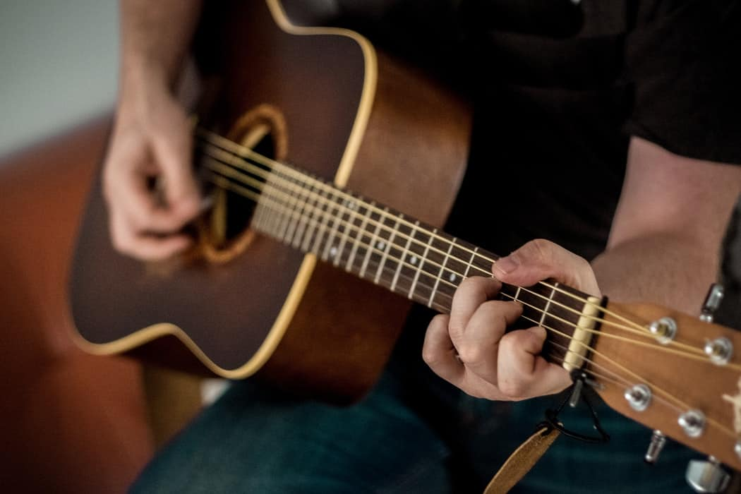 Easiest instrument to learn for adults, the acoustic guitar.
