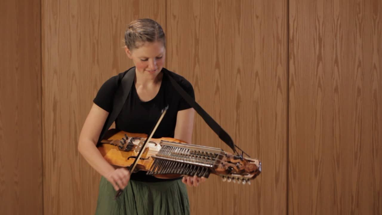 Girl playing the nyckelharpa.