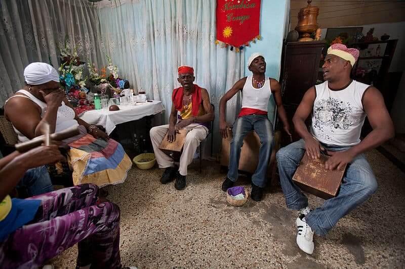 People playing the Cuban Cajon in Havana.