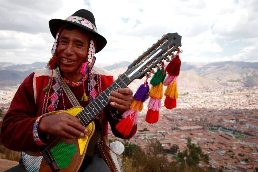 Peruvian playing a Charango at Cristo Blanco, Cusco, in Peru