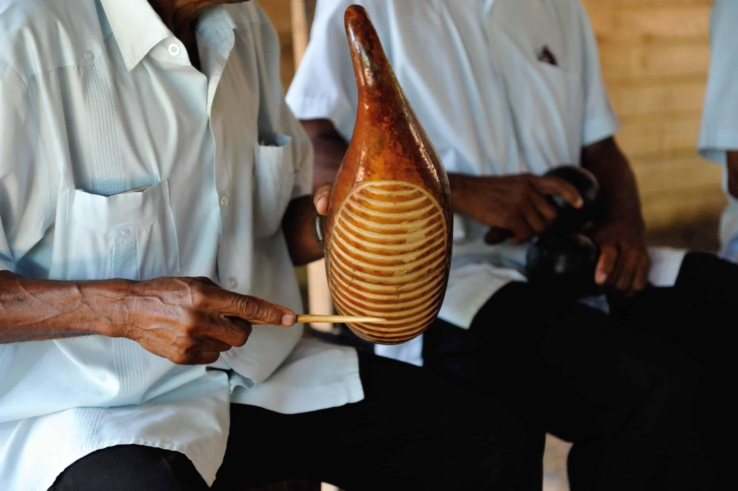 A man playing the güiro in Cuba.