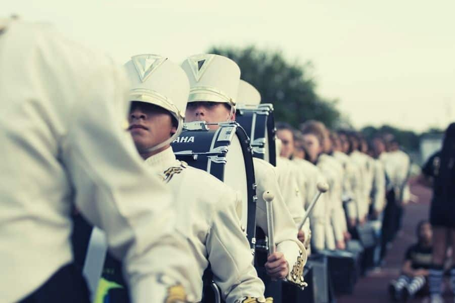 A band and their marching band instruments.